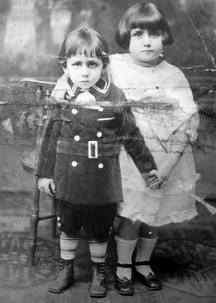 with his sister, Angela, in 1921
